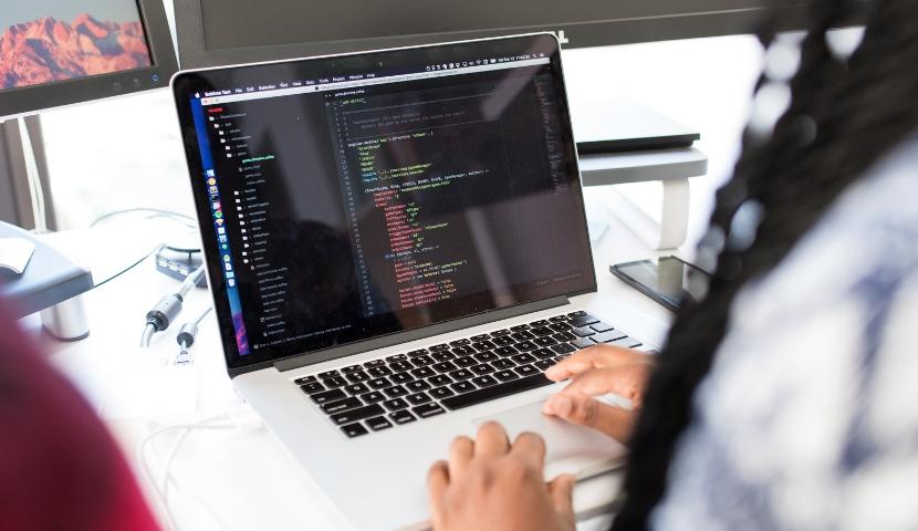 Woman writing code