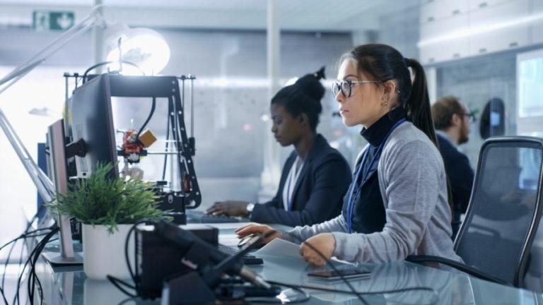 Women looking a data computer