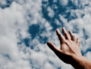 Man reaching for the clouds